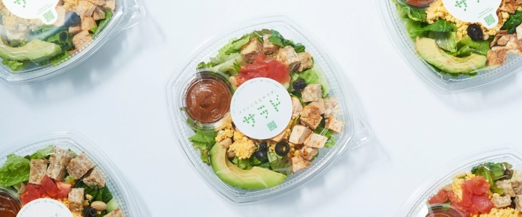 boxed asian salads on white background