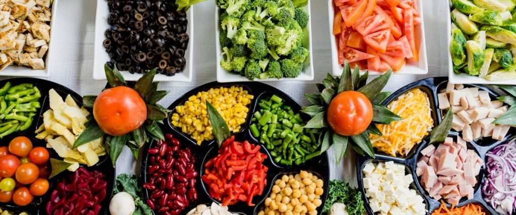 assortment of vegetable platters and salad ingredients