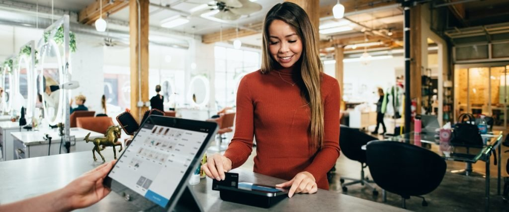woman paying with credit card at cafeteria