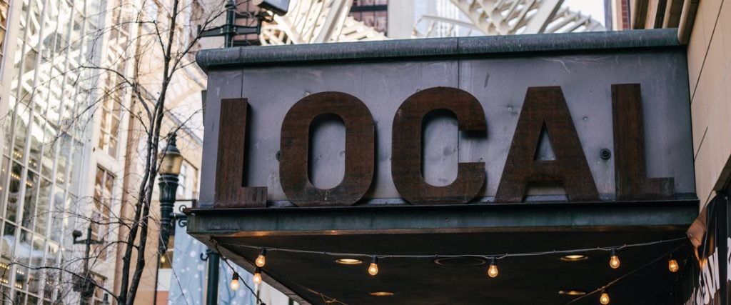 """large outdoor sign reading """"local"""""""