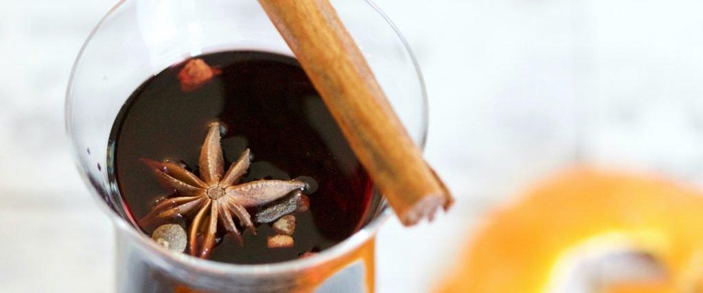 mulled wine with cinnamon stick and orange peel